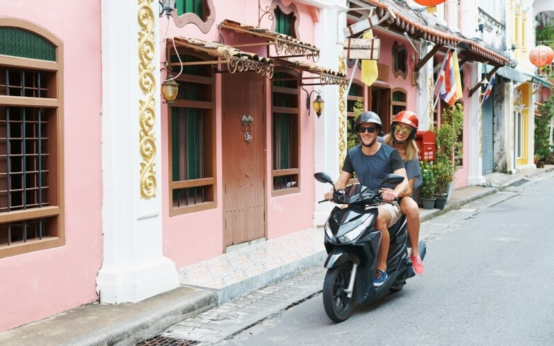 Young couple on motorbike abroad