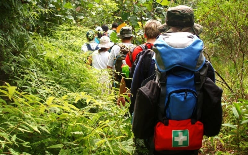 trekking through jungle with first aid bag